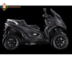 un scooter 4 roues de marque Italo-Suisse 350cc